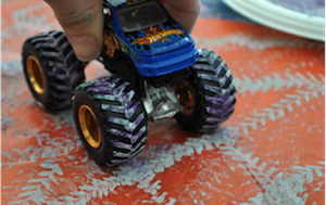 use toy trucks to make printed art