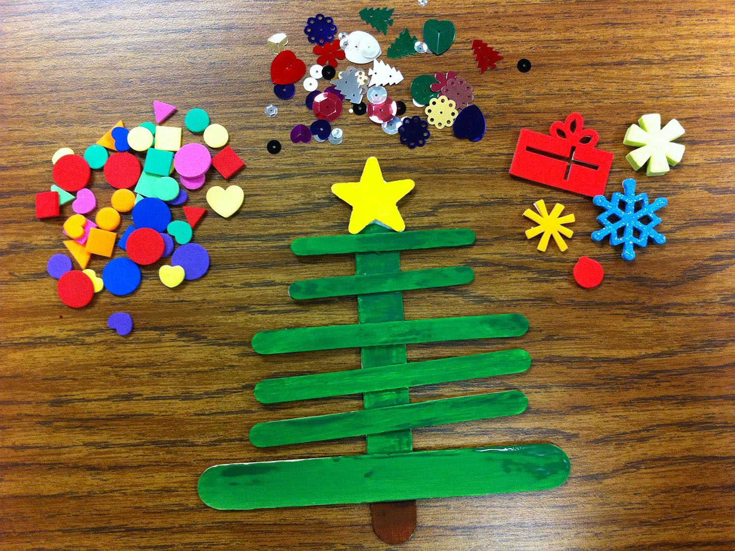 Holiday craft craft stick christmas trees scholastic for Christmas projects with popsicle sticks