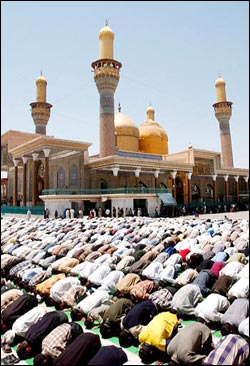 Shiites pray at the Moussa al Kadhim shrine