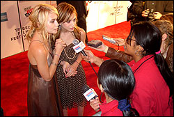 Lisa Pimentel (right) and Janus Chan interview the Olsen twins.