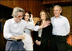 Japanese Prime Minister Junichiro Koizumi (L) does an Elvis Presley imitation during a visit to Graceland, on June 30, 2006. From L-R are: Koizumi, Priscilla Presley, Lisa Marie Presley, and President Bush.
