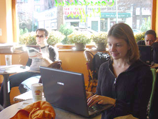 Shana Corey, author, writing in a coffee shop