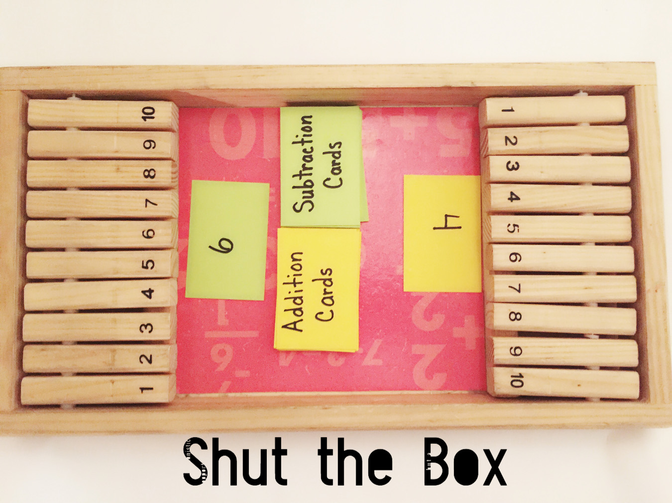 A Shut the Box game with addition and subtraction cards