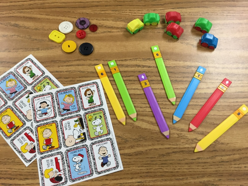 Different ways to group students - sticks, buttons, cars, and stickers