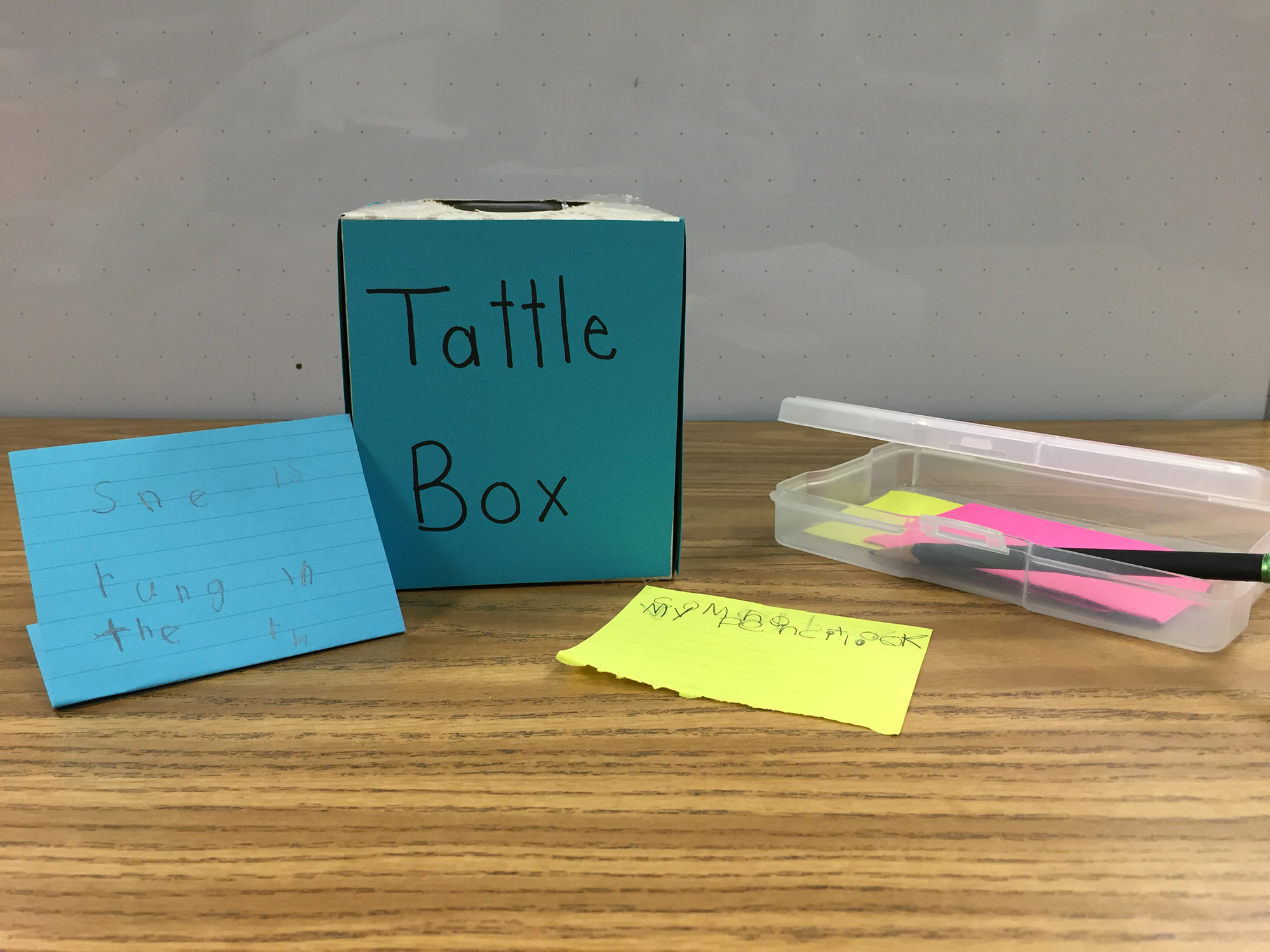 A decorated tissue box to put tattles in