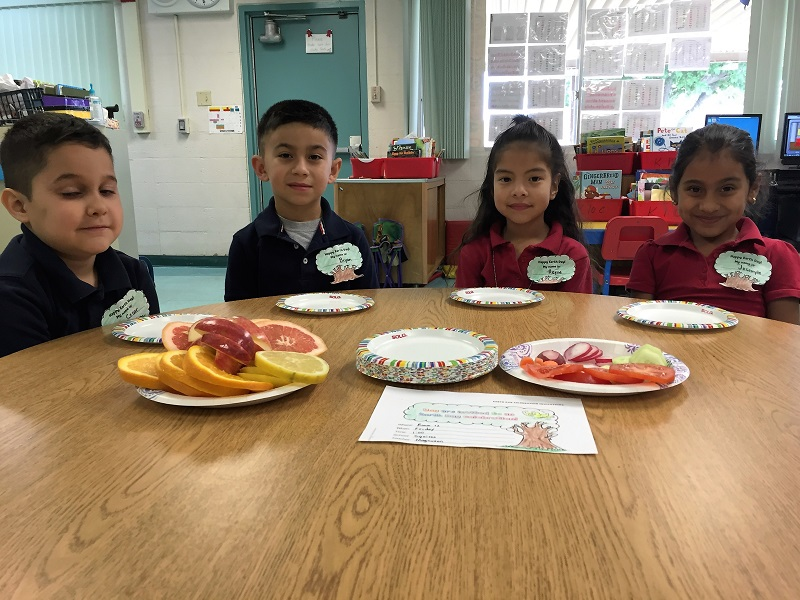 Kids eating fruits and vegetables for Earth Day