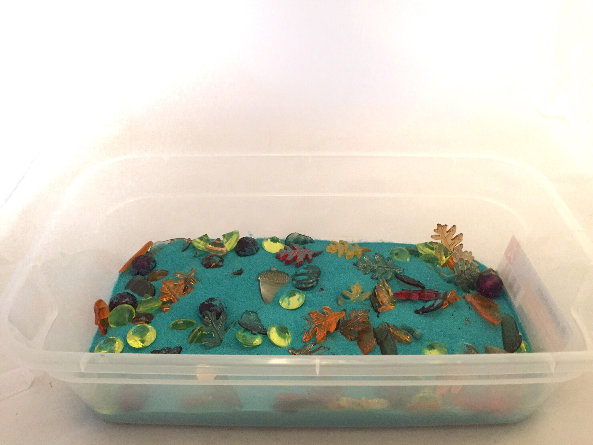 Daytime Sensory Bin With Blue Sand