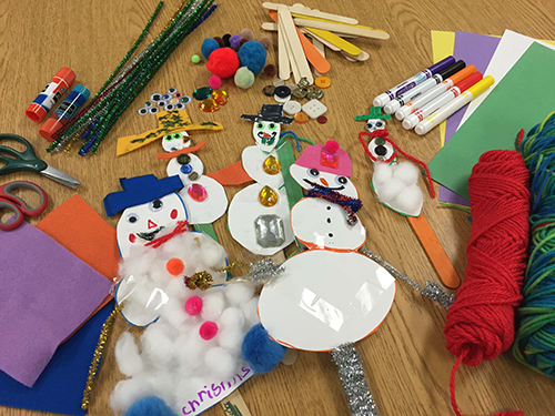 Snowmen made from miscellaneous crafts