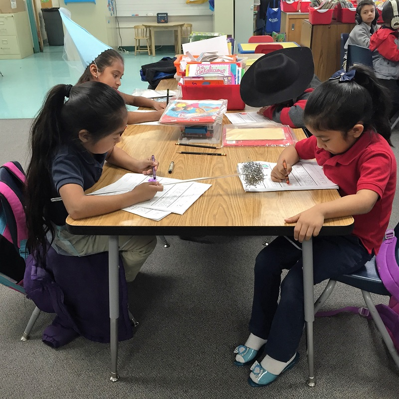 Kindergarteners Being Playful: Working While Wearing Dress-Up Clothes