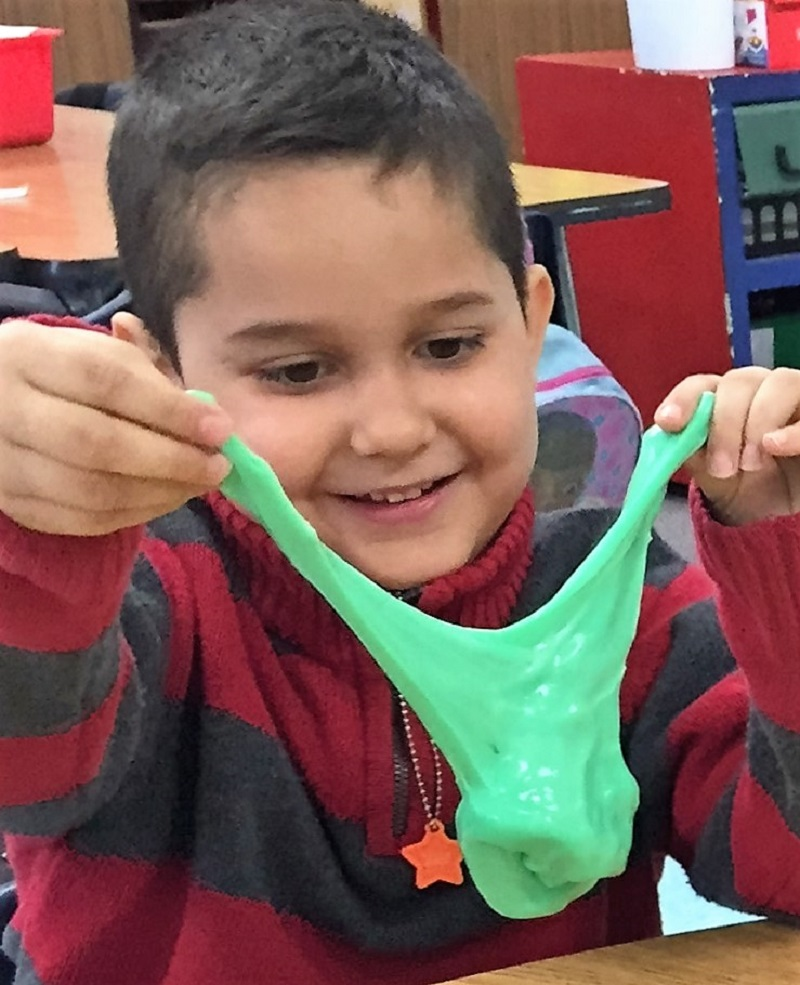 Kindergarteners Being Playful: A Boy Playing With Slime