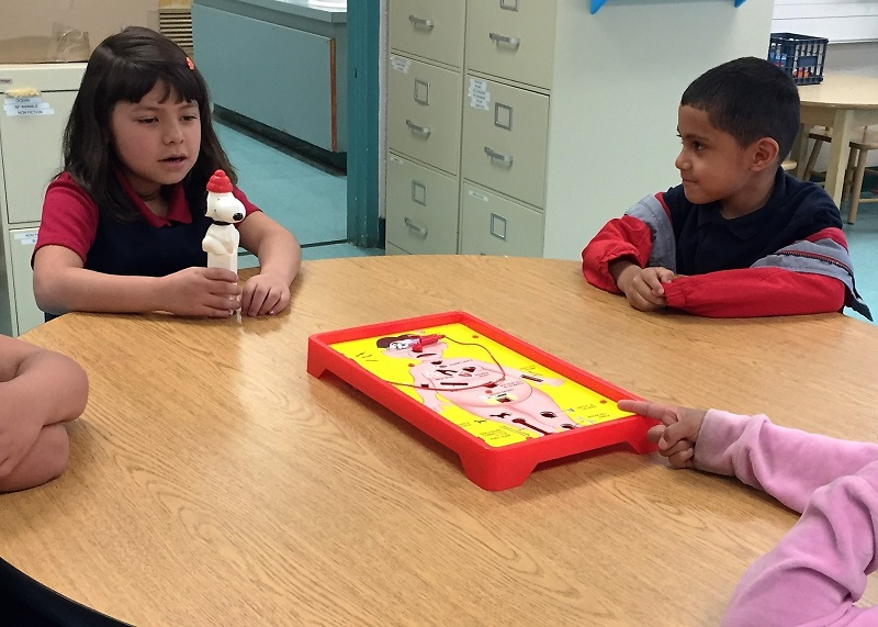 "Kindergarteners Having Fun: Kids Discussing Rules for the Board Game ""Operation"""