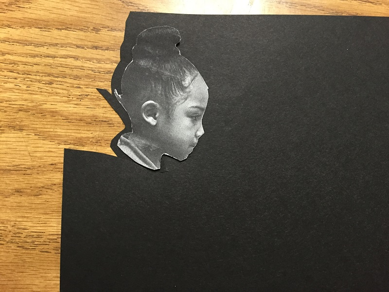 Cut silhouettes onto black paper