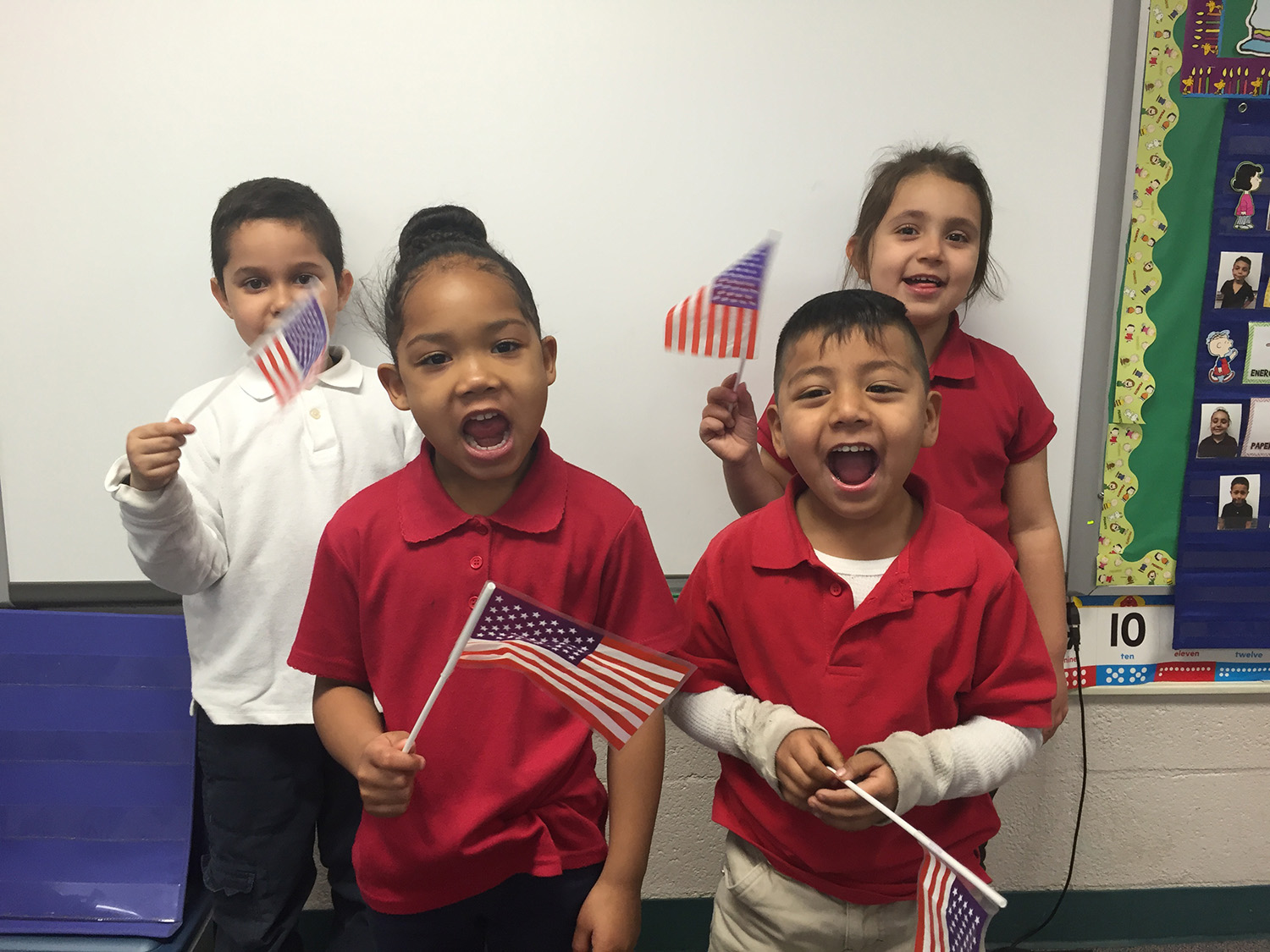 Kids singing and waving American flags