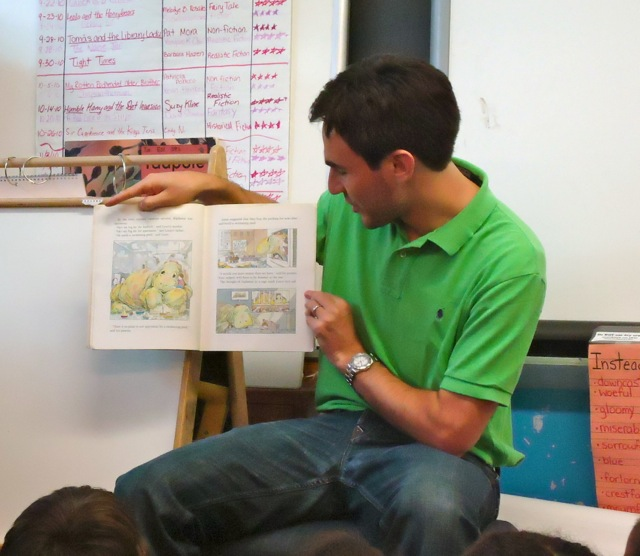 My husband reads to the class.