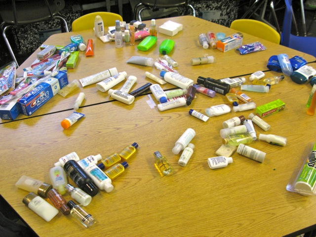 Students count the toiletries we collect each day.