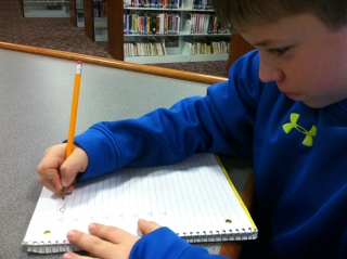 Andrew practicing cursive