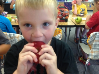 Landon eating an apple
