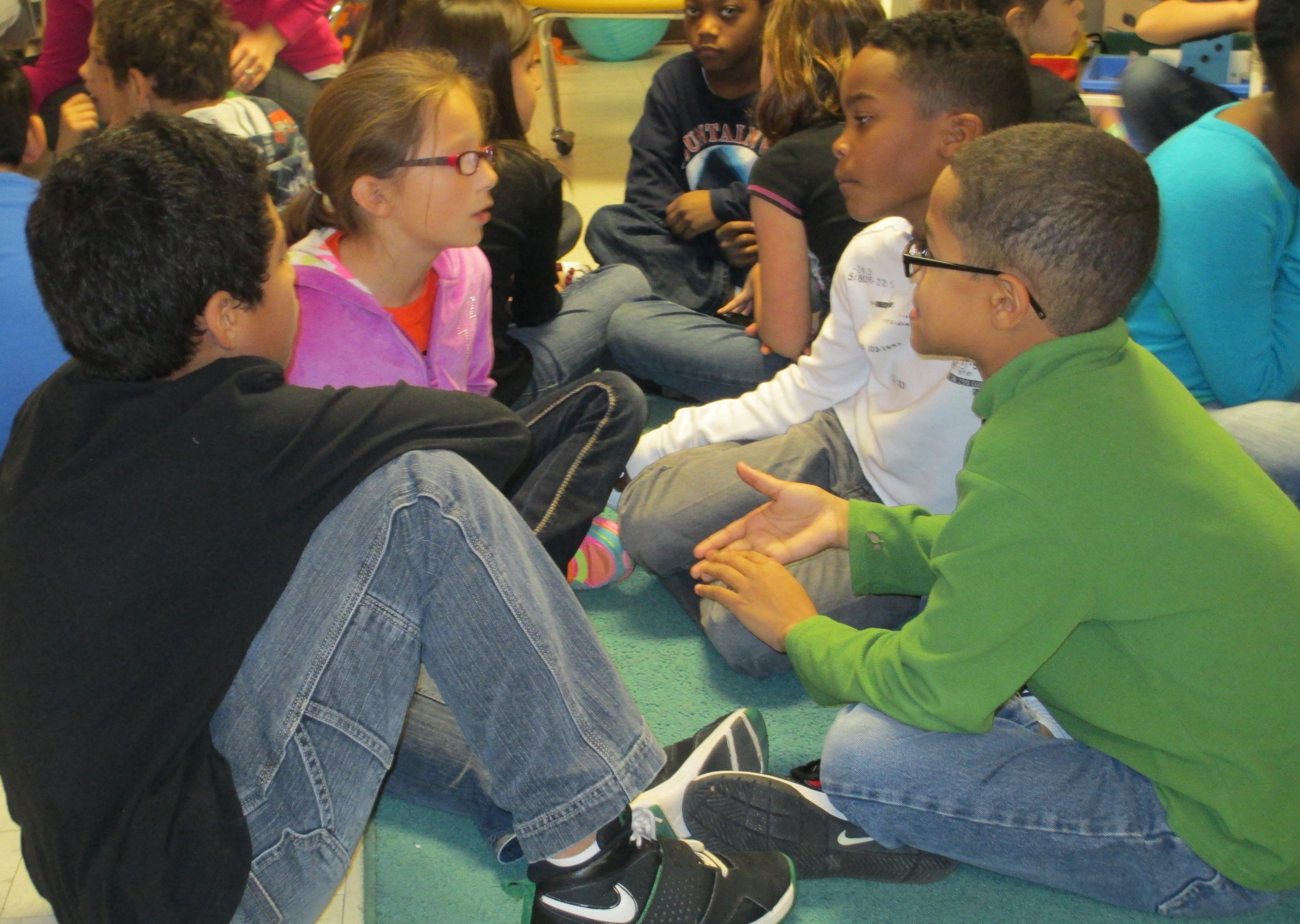 Students talk in book clubs