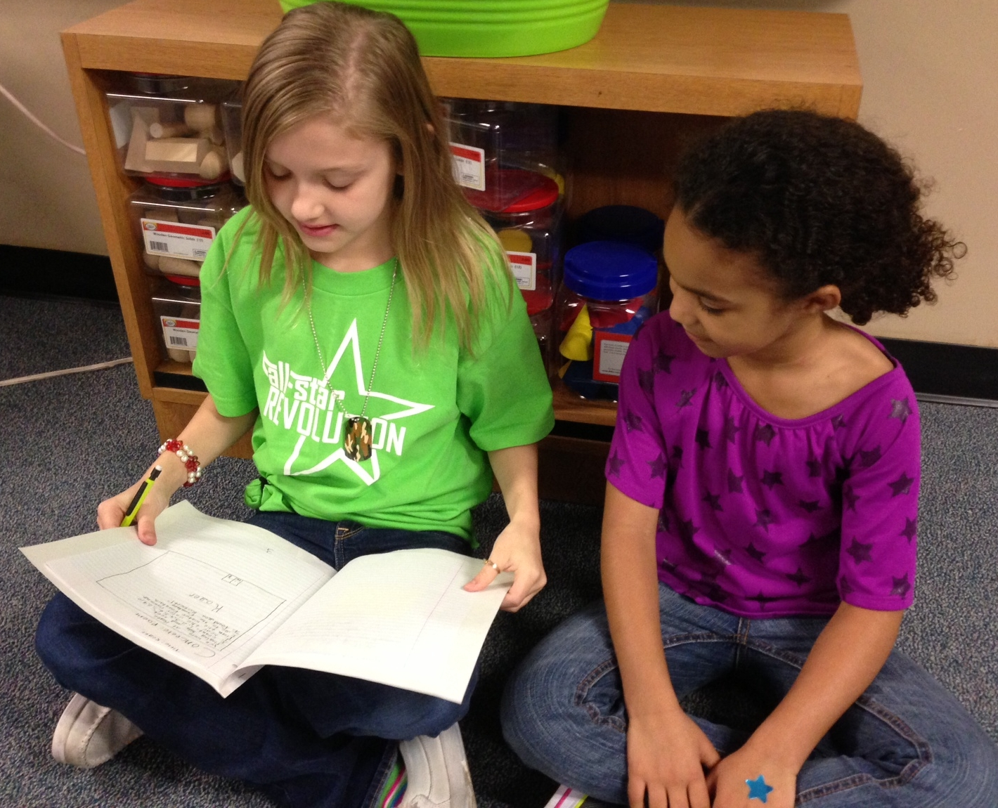 Two students sharing a piece of writing