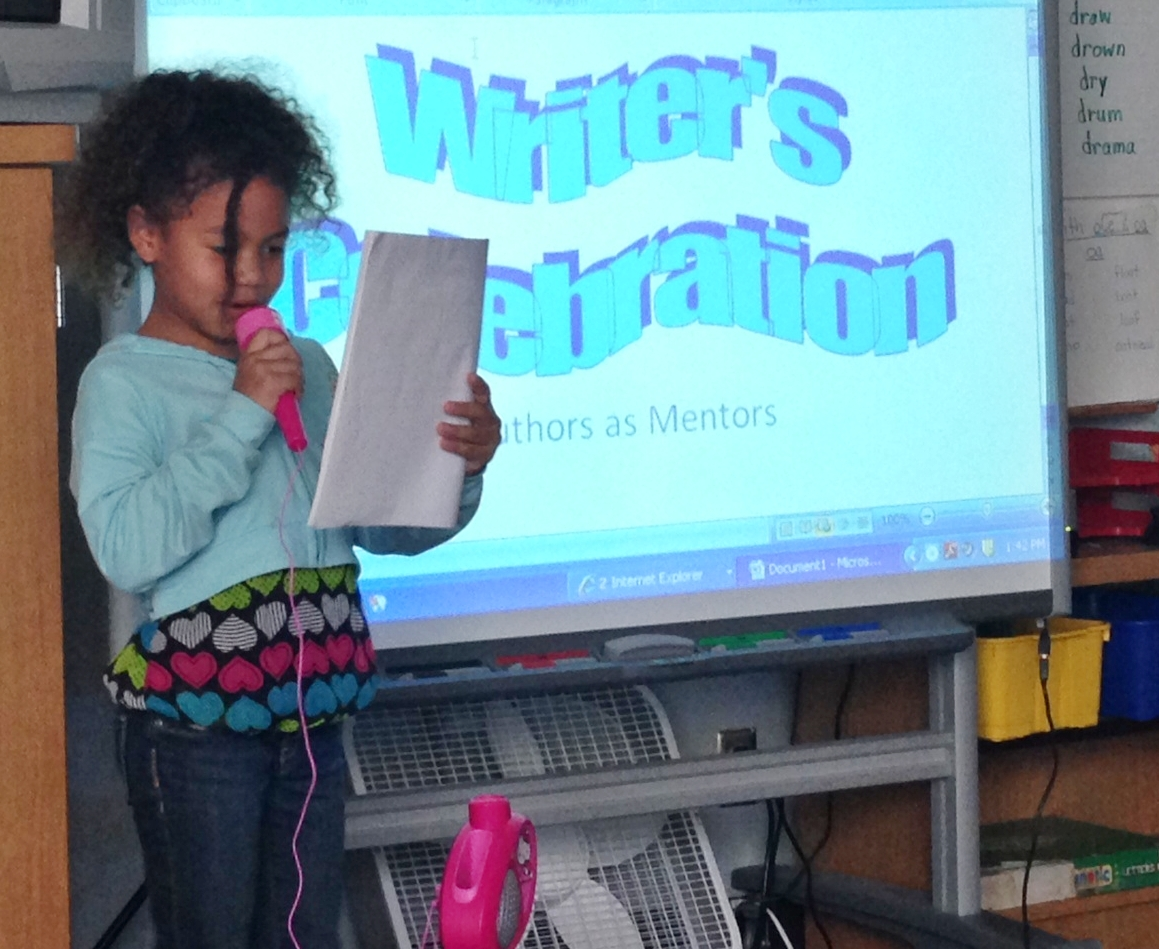 Student sharing writing on microphone