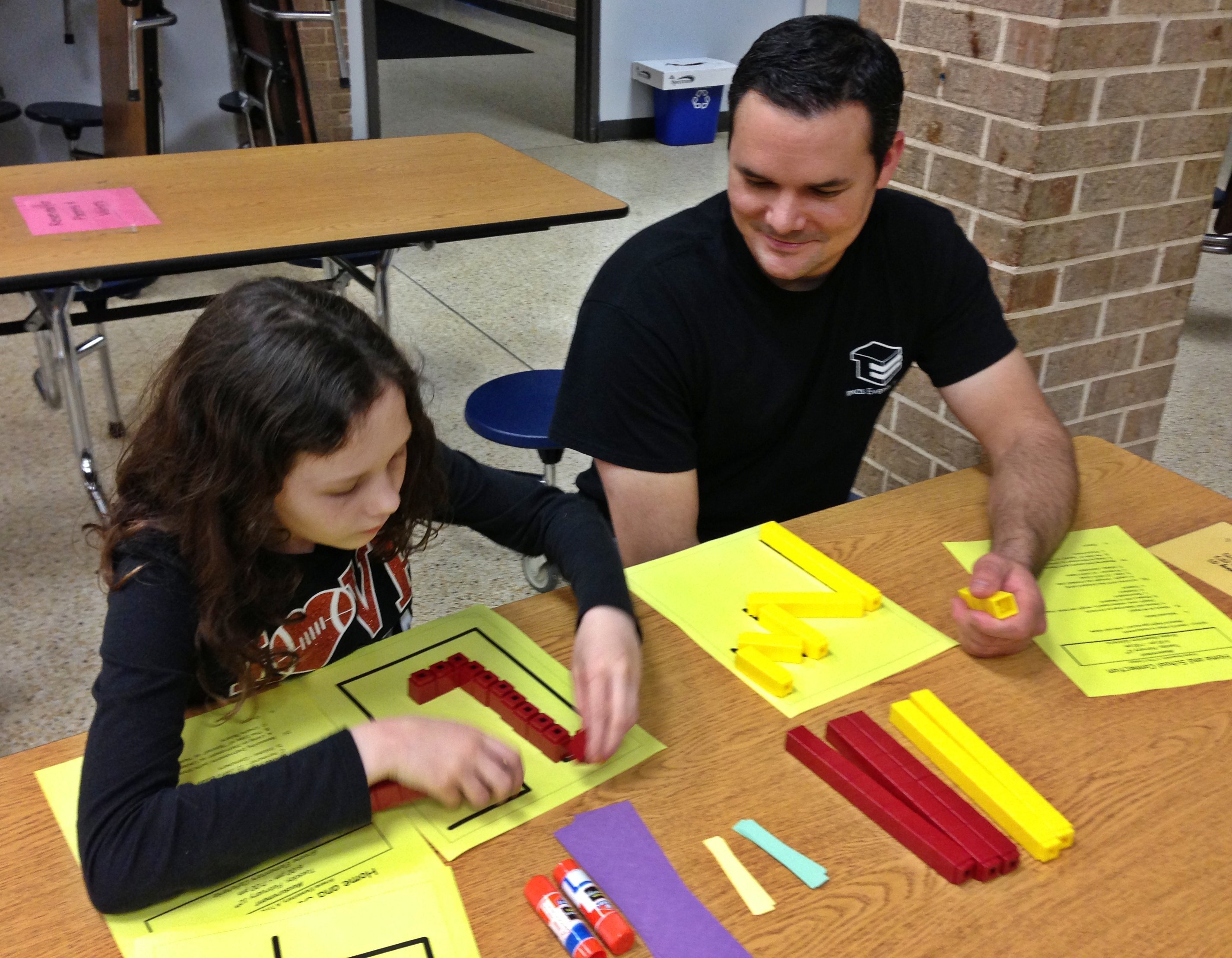 Student and parent working on math task