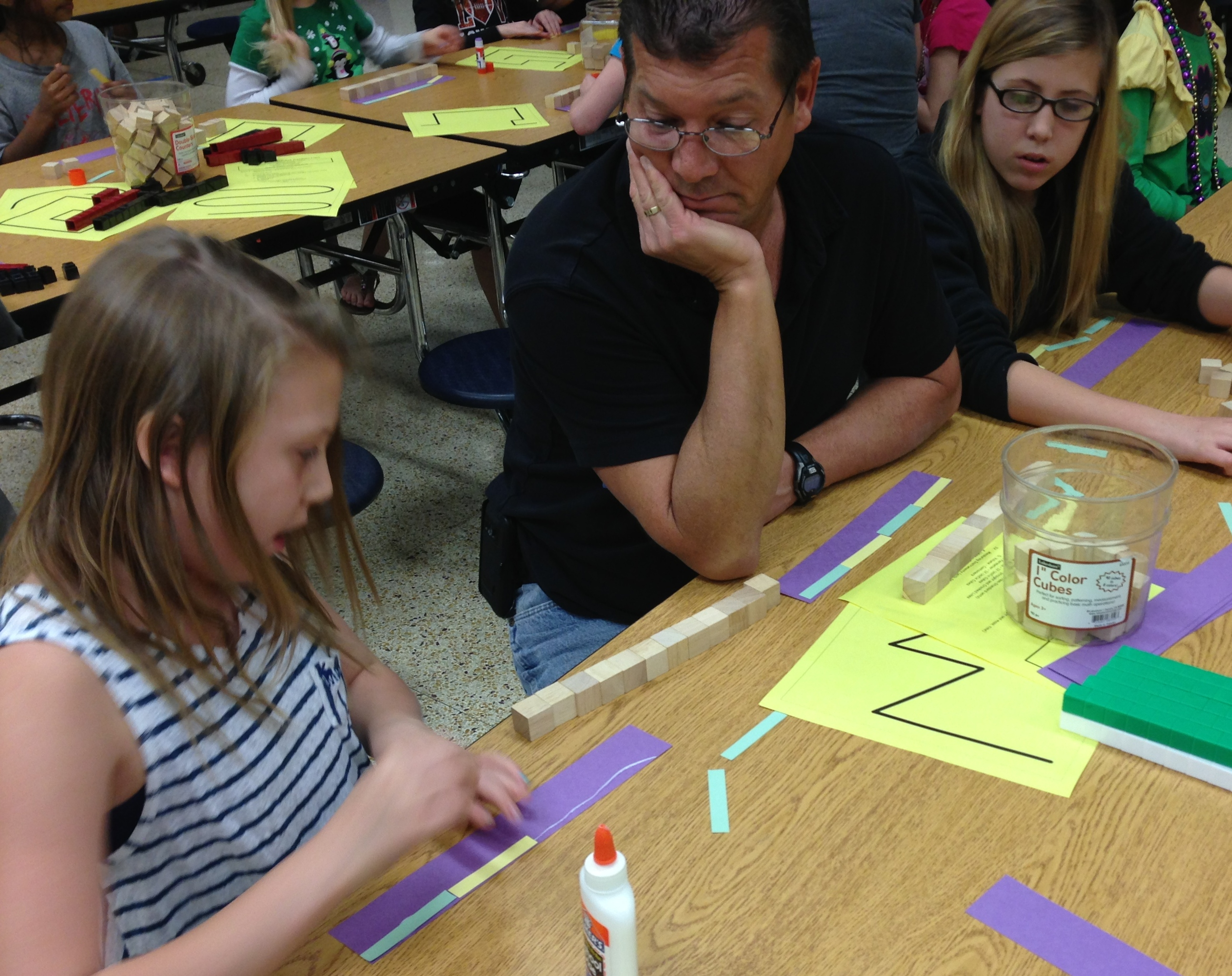 Students and parent working on math task