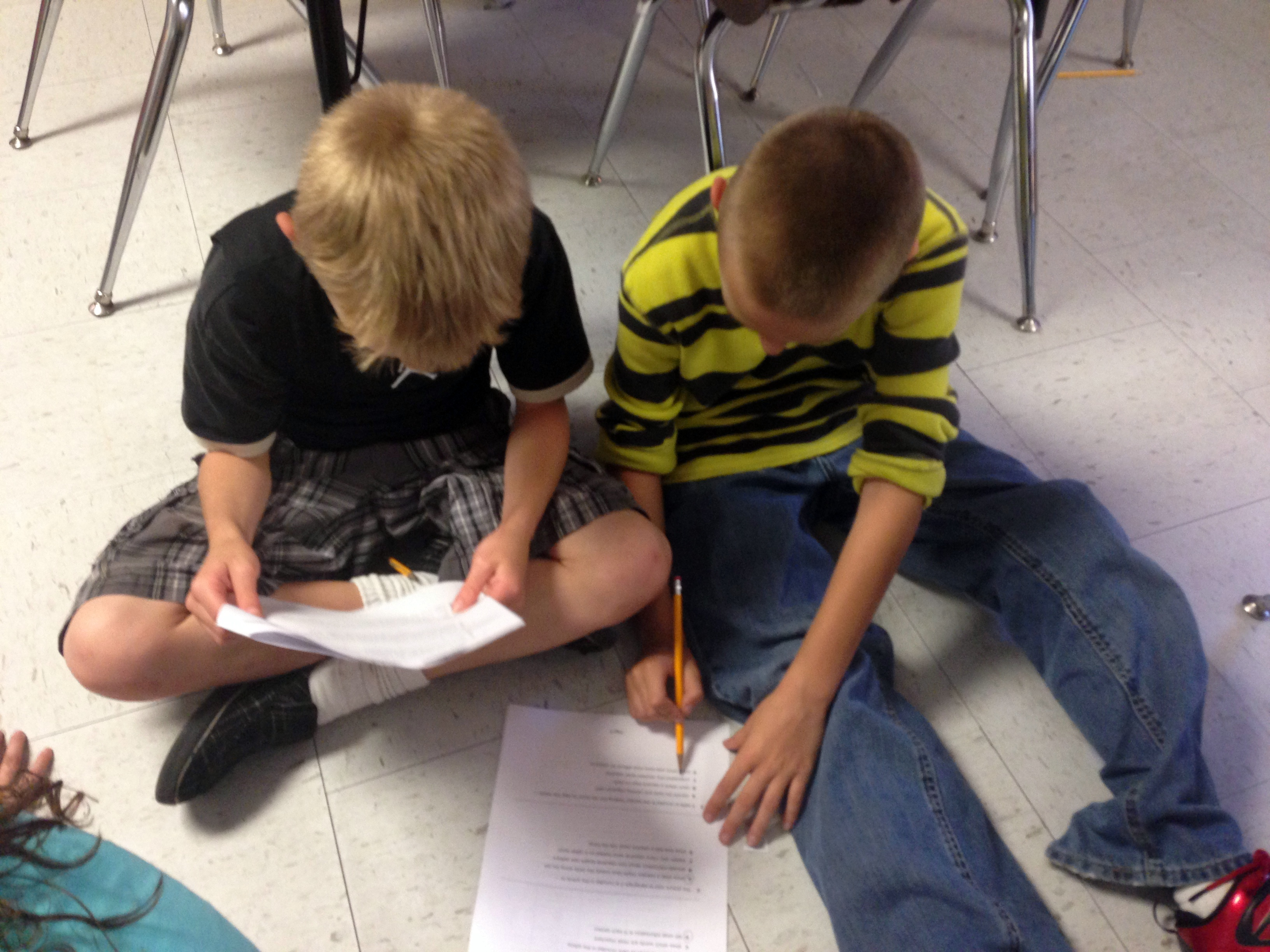 2 boys working in a club to discuss a reading passage