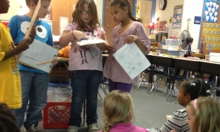 students presenting part of a pilgrim letter to the class
