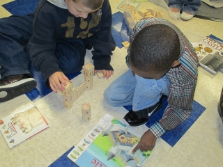 boys build castle with blocks