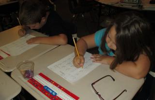 students performing addition facts timed assessment