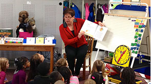 Teacher teaching children how to read